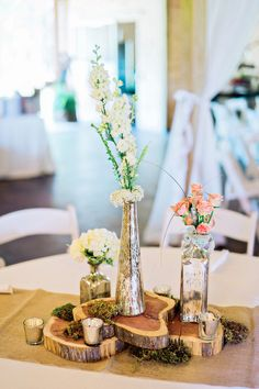 Rustic-chic reception centerpiece idea - pink and white flowers in mercury glass vessels on wood slices {Andie Freeman Photography}