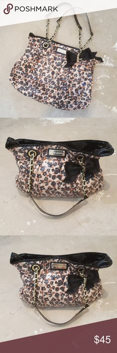 """Betsey Johnson Leopard Tote Bag I am selling a super sassy and sexy Betsey Johnson Tote.  This designer is known for funky chic-ness and this bag is the epitome of that vibe!  I LOVE the leopard print completly covered in sequins, as well as the gold chain detail on handles and signature nameplate.  Bag is in excellent condition, as I've never actually worn it.  The signature hardware have minimal scratching from being """"shuffled"""" around my closet.  BE BOLD!! Betsey Johnson Bags Totes"""