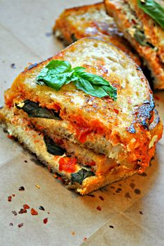Vegan ricotta, marinara and basil all inside crusty delicious bread. This vegan pizza grilled cheese is the best grilled cheese ever!