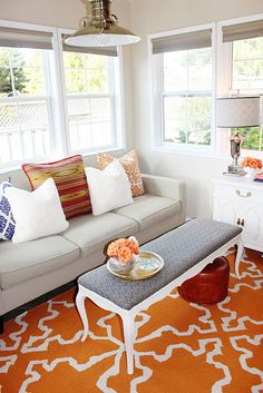 Bright orange rug - love this! This would look fantastic in a room with with navy, chocolate brown and white furniture/decor.
