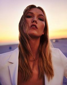 Karlie Kloss // long wavy hair, bronzed beauty and a white blazer #style #fashion #campaign