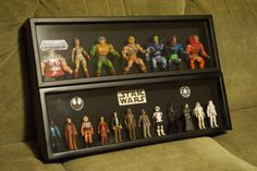 For Father's Day this year, my wife thought of a great way for me to show my action figures.   She got shadow boxes to put the figures in, which we will hang up in the bar/dining room.  I used a craft double sided patch to hold the figures.  Then I printed out logos for the background.   These are Star Wars and He-Man boxes.  Plan on doing Teen Titans, GI Joe, and maybe misc figures (Rorschach, Batman, Walking Dead).