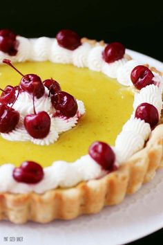 A delicious lime curd filling with a lime tart crust and homemade whipped cream and maraschino cherries.