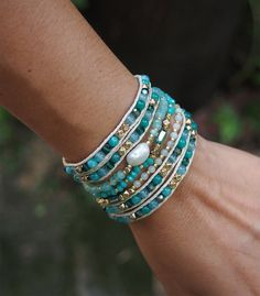 Crafted with a combination of semi-precious stones, crystals and plated metal, this wrap bracelet is designed to give you an effortless layered look. It can also be worn as a necklace.  ✧ Mix include : Blue Quartz, Amazonite, Freshwater pearl, Crystal, plated metal beaded. ✧ Length : 82cm with adjustable. ✧ Closure : Button ✧ Fits a 6 to 7 inch wrist wrapped 5 times.   PLEASE NOTE : The handcrafted nature of this product will produce minor differences in design, sizing and weight. Variations…