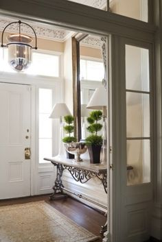Bright and light - I like the idea of narrow table (but needs a couple of drawers, lamps, mirror...also glass panes set next to the inside door.
