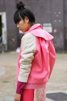 Pink backpack-jacket. YES. http://www.stylebubble.co.uk/style_bubble/2011/10/packing-in-the-back.html