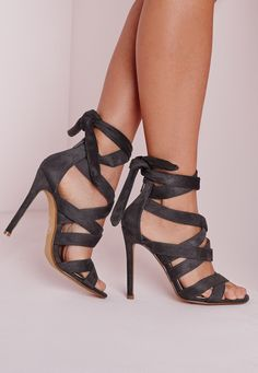 We've fallen head over heels for the hottest shoe of the season! Step out in style in these lust have grey heeled sandals. Featuring cut out strap detail, zip to the back and a wrap around your ankle style finish, all eyes will definately b...