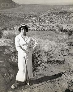 Original caption:Palm Springs, CA- Enjoying her first vacation in two years, Anita Loos, petite authoress and screen writer, photographed at Palm Springs, California, where she spends most of her time hiking in the mountain area back of the Desert Inn. Miss Loos is Mrs. John Emerson in private life. Undated photograph.