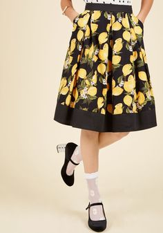 Do the Ripe Thing A-Line Skirt | ModCloth In a world of incredible skirt options, how's a girl to choose the perfect one? This black A-line makes itself the obvious choice with its essential side pockets, crisp pleats, and vibrant lemon print, meaning the only decision you're left with is pairing it with your favorite pieces!
