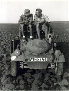 """Brandenburgers in North Africa: In June 1942, a detachment of the Brandenburg Regiment codenamed """"Special Force Dora"""" was used to carry out reconnaisance missions in Libya. Two members of the unit are seen here sitting on their Kubelwagen. The unit insignia - a red scorpion on a white shield - is painted on the right mudguard."""