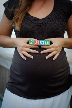 I love this idea! Little wooden blocks to spell out the baby's name.