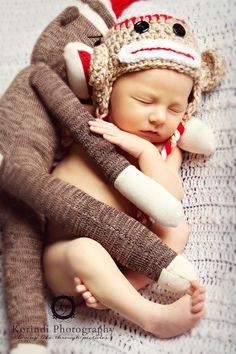 CUTE newborn pic! Then be sure & pack that toy away for when they grow up!!