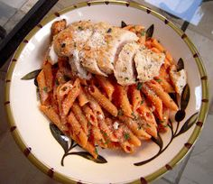 Grilled Chicken & Tomato Cream Sauce:  1/2 Lawry's Herb & Garlic marinade  2 Tbsp. pesto  2 boneless chicken breasts, pounded thin    1/2 pound penne pasta  2 tsp olive oil  1 shallot, diced  2 cloves garlic, minced  1/2 cup chicken broth  1 (8-ounce) can tomato sauce  1 cup half & half  1 tsp flour  salt & pepper (to taste)  1 tsp basil