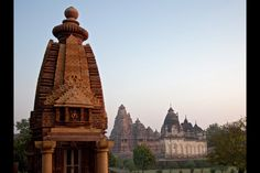 Temples of Khajuraho, India - Khajuraho is a small town with dozens of ancient temples dotting its landscape. They were built here over a span of 200 years, between 950 and 1150 AD. The temples are known for the erotic sculptures and intricate carvings on their walls.