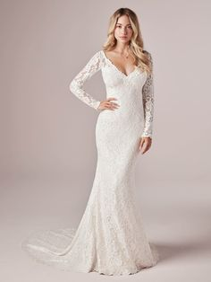 Rebecca Ingram Tina Dawn - Lace is classic. Amp up the charm with illusion details and a super sexy neckline. It's easy-breezy in this long-sleeved sheath wedding dress in boho-inspired lace.