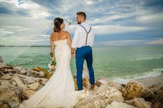 Nothing more romantic than a beautiful bride, a handsome groom, and a Phantom 4 Pro http://celebrationsoftampabay.com/photographers-clearwater-beach/