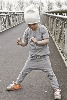 Stylish and ready to play- beanie, dipaer pants and the white tee.