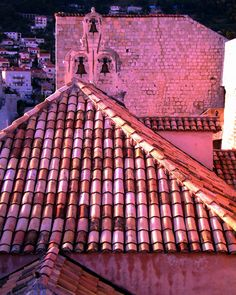 Red tiled roof and bell tower at dusk. Dubrovnik, Old Town, Southern Dalmatia, Croatia