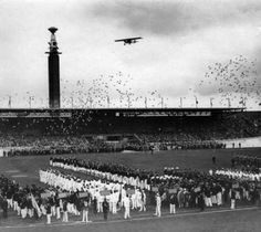 The Olympic Stadium with cauldron, plane flyover and the release of pigeons