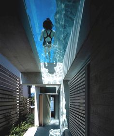 Amazing see-through glass swimming pools. A great design solution for elevated and small sized swimming pools. #Dailylifebuff