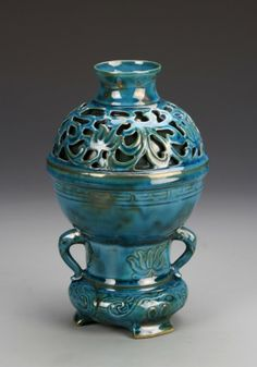 China, Lunquan glazed jar, in a bright blue color, with areas of openwork and plant and floral designs. Height 8 in.