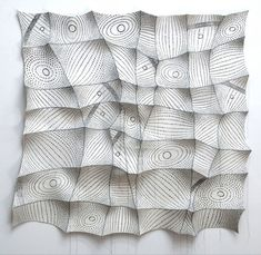 Chung-Im Kim silk screens patterns onto industrial felt pieces, hand stitching the felt to create dimensional wall sculptures...