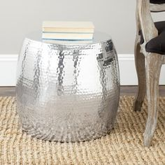 @Overstock.com - Safavieh Vanadium Silver Round Table - This shimmering round end table offers a bold appearance that is sure to capture attention in any room. Made from aluminum, it is both durable and elegant in design to function as both a modern accent piece and for storage or display.  http://www.overstock.com/Home-Garden/Safavieh-Vanadium-Silver-Round-Table/7388205/product.html?CID=214117 $128.99
