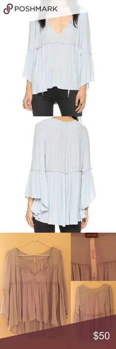NWOT Free People Few of My Favorite Things Blouse NWOT, never worn. Size small. A ladylike Free People blouse with a gathered empire waist and dramatic bell sleeves. Tie keyhole neckline. High-low hem. Free People Tops