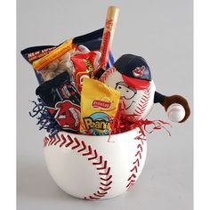 The perfect gift for your favorite baseball fan, this Big League candy bowl is sure to hit a home run. The baseball-shaped container is stuffed with a variety of tasty snacks. A plush baseball charact