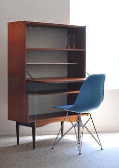 MCM secretary desk. This would be handy. The dining room table is constantly covered with my text books and homework now.