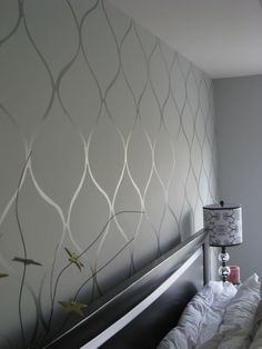 Design using high gloss paint of same wall color. For the strips in the spare bedroom re-do