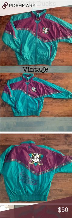 Vintage collectible mighty ducks jacket Vintage collectible mighty ducks jacket. In perfect condition, purple and teal with mighty ducks patches and embroidery. No flaws on the Coat, has front pockets and functioning zipper. Jackets & Coats Windbreakers