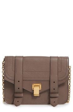 Loving this leather chain wallet that features messenger styling and flip-lock hardware.