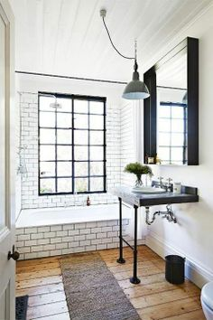 Beautiful bathroom. Industrial + vintage. Large window. Subway tile. Wood floors.