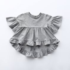 Leah ~ Grey Frill Tee (toddler) A boho frill top made from a luxe cotton. We have it for mommy & dolly! See the Mommy & Me section for the Mommy sizes. Baby Girl Fashion, Toddler Fashion, Kids Fashion, Womens Fashion, Toddler Swag, Toddler Girls, Cheap Kids Clothes, Kids Clothing, Infant Clothing