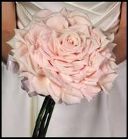 Composite: A composite bouquet is made of petals wired or glued together to form a single large bloom with a ribbon tied to it.