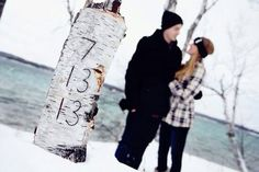 date carved in tree, couple in back