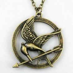 The hunger games bronze mockingjay necklace by Moviejewellery