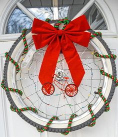 Bicycle Wheel Christmas Wreath http://livedan330.com/2015/12/16/bicycle-wheel-christmas-wreath/