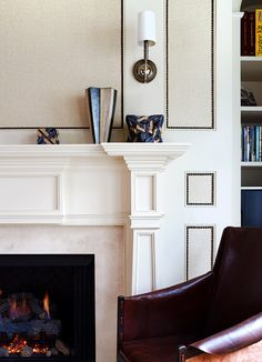 Woven wall coverings framed with nailheads. Room by Skip Sroka. Fireplace Design, Fireplace Ideas, Fireplace Molding, Library Fireplace, Fireplace Mantles, Fireplace Wall, Moulding, Wall Panel Design, Wall Trim