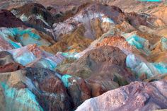Artist's Palette, on the face of the Black Mountains in Death Valley. The varying colors of rock are caused by the oxidation of different metals (red, pink and yellow from iron salts, green from decomposing tuff-derived mica, and purple from manganese). MANGANESE!