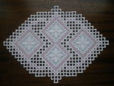 This precious uniquely shaped doily is done on white linen fabric with white perle cotton thread and accented in pink. It measures 10 (25cm) x 7 (18cm) and was meticulously stitched by me. It looks very pretty on a table or hanging on a wall or in a window. Any questions feel free to email me. It will ship upon receipt of payment via USPS. As always, Thanks for Looking :)