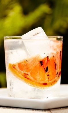 Meant for long afternoons overlooking lakes, porches, and thick novels, gin and tonics are the balm of summer. Add a slice of salt-sprinkled grilled grapefruit, and cut the tonic with soda, and the highball grows not only more aromatically complex, but even more refreshing.