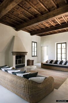 Living Room Italian Retreat with a Mix of Styles. Love the wicker couch.