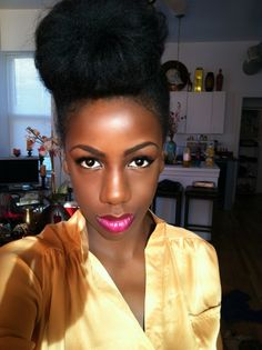 I love this take on the bun for natural hair. I wonder if my hair is long enough for this...