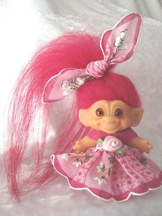 Troll doll...I remember these except mine had fuschia hair & it was naked :/