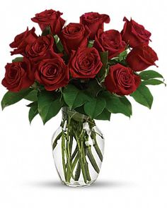 Valentine's Day shouldn't be complicated. Send this Classic & elegant bouquet of a dozen medium stem red roses in a clear glass vase. Simple greens and flowers make this arrangement a sure thing.