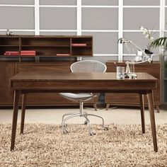 Catalina Desk with Keyboard Tray by Copeland Furniture is suggestive of the works of America's mid-century modern designers.
