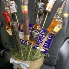 Man Bouquet- I'll put the little bottles of Crown Royal & some individual snacks b/c my DH doesn't smoke cigars. What a cute idea!