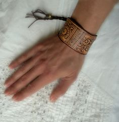 I freehand pyrographed this soft repurposed leather with filigree and chevrons to create this boho leather cuff. The leather is very soft and light, Leather Bracelets, Leather Cuffs, Leather Jewelry, Cuff Bracelets, Sketch Books, Diy Purse, Leather Pieces, Henna Designs, Filigree